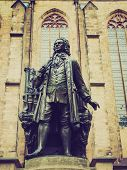 stock photo of leipzig  - The Neues Bach Denkmal meaning new Bach monument stands since 1908 in front of the St Thomas Kirche church where Johann Sebastian Bach is buried in Leipzig Germany - JPG