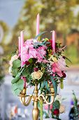 foto of wedding feast  - Floral arrangement to decorate the wedding feast the bride and groom. Flowers candles vintage.