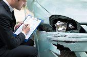Agent Examining Car