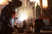 foto of manufacturing  - Industrial Worker at the factory welding closeup - JPG
