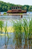 picture of nuclear disaster  - Wrecked abandoned ship on a river after nuclear disaster in Chernobyl Ukraine - JPG