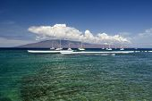 Entrance to Lahaina Harbor with boats and the island of Lanai, Maui, Hawaii