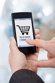 Hands Shopping Online On Smartphone