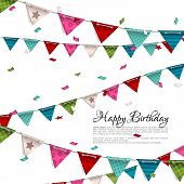 Birthday card with confetti and bunting flags.