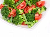 Broccoli salad with french beans and tomatoes.