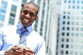 Smiling Male Executive Using His Mobile Phone