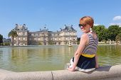 Smiling Young Woman In Luxembourg Garden