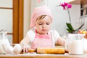Kid Girl Preparing Dough In The Kitchen At Home