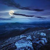 Stones On The Mountain Hillside At Night