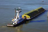 stock photo of workhorses  - Push boat and a barge positioning for mooring - JPG
