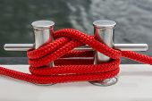 Red Rope Fasten On Stake Of Yacht