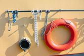 Orange Lifebuoy On Metal Ship