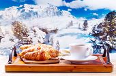 picture of apr  - cup of coffee and croissants on wooden table over winter landscape