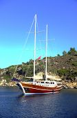 Sailing boat anchored in bay