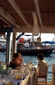 Tourists lunch in fish restaurant
