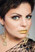 Beautiful woman with perfect gold make up