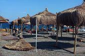Wicker parasols on beach