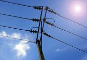 foto of sun perch  - electric cable on concrete pole with sun light - JPG