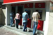 People withdrawing money from ATM machines