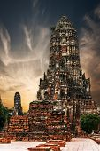 View of ancient Chai Watthanaram temple ruins under sunset sky. Ayutthaya Thailand