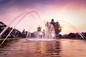 Sunset View Of Patuxai Arch Or Victory Triumph Gate Monument With Fountain In Front. Vientiane, Lao