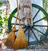 Straw broom with wooden wheel