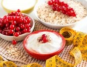Cereals With Red Currants,  Yogurt And Measuring Tape