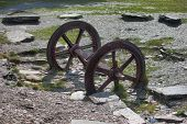 A Pair Of Old Disused Metal Mine Train Wheels