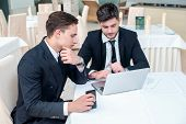 Recruitment. Two Successful And Confident Businessman Sitting At The Table In A Business Office In F