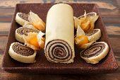 Bolo De Rolo (swiss Roll, Roll Cake) Brazilian Chocolate Dessert With Physalis