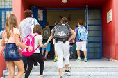 Students With Their Backpacks Getting Into School. First Day Of School For The Students In Thessalon