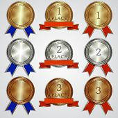 Vector set of metallic badges with ribbons  for the first, second, third place