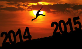 picture of jumping  - Silhouette person jumping over 2015 on the hill at sunset - JPG
