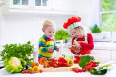 Children Preparing Healthy Vegetable Lunch
