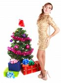 Portrait Of A Beautiful Young Woman Near The Christmas Tree And Presents