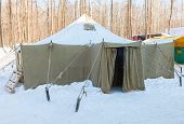 Big Military Tent At The Winter Park In Sunny Day