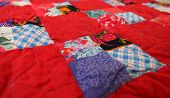picture of quilt  - patchwork art quilt in the village interior - JPG