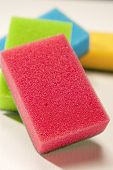 Pile Of Kitchen Colorful Sponges On White Surface