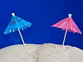 Cocktail Umbrellas In The Sand