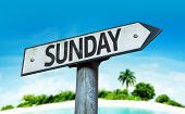 Sunday sign with a beach on background