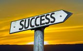 Success sign with a sunset background