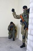 stock photo of ak 47  - rebels with AK 47 inside the building - JPG