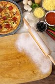 Pizza With Chopping Board And Ingredients