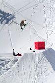Snowboarder jumps in Snow Park,  mountain ski resort