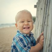 Cute caucasian baby laughing. Outdoor portrait