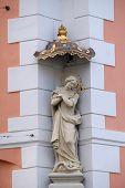 GRAZ, AUSTRIA - JANUARY 10, 2015: Virgin Mary, statue on the house facade in Graz, Styria, Austria on January 10, 2015.