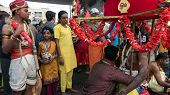 KUALA LUMPUR, MALAYSIA - FEBRUARY 3, 2015: Hindu devotees wait to join a procession walking to the Batu Caves temple on Thaipusam day, a day of thanksgiving and devotion to Lord Muruga.