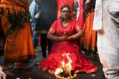 KUALA LUMPUR, MALAYSIA - FEBRUARY 3, 2015: A Hindu devotee performs prayers at the Sri Mahamarriamman temple in Batu Caves. Hundreds of thousands of devotees come here for the Thaipusam prayers.