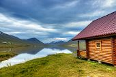 Log cabin on a scenic lake in Northern Iceland