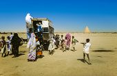 People Try To Get On An Overland Bus In Shendi